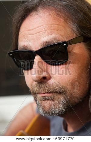 Portrait Of A Nonconformist Middle-aged Man