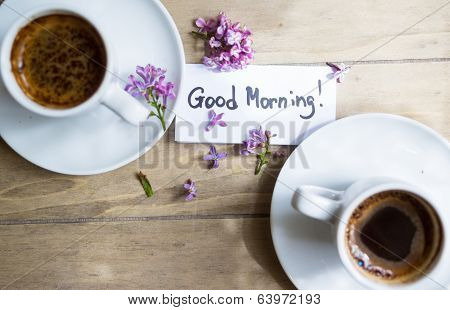 Cup Of Coffee And Lilac Flower