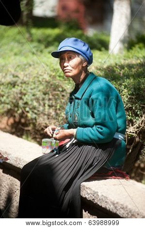 Chinese Naxi Old Woman Is Knitting.