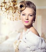 Luxury Styled Beauty Lady Portrait. Retro Woman. Beauty Fashion Vintage Style Girl with Beautiful Hairstyle, makeup, accessories. Golden Silk Gloves, dress, expensive white fur coat, Luxury interior poster