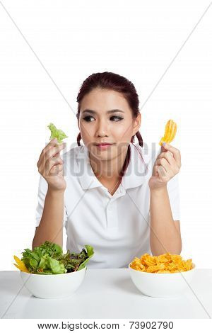 Asian Girl With Salad And Crisps In Her Hands