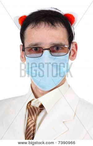 Man In A Medical Mask And With Pig Ears