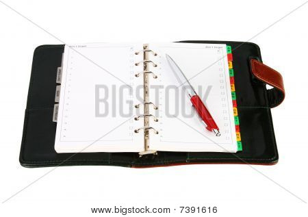 Open Leather Office Organizer With A Red Pen