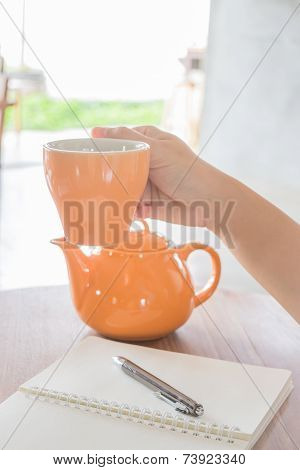Hand Hold On Hot Cup Of Tea