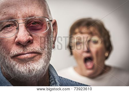 Battered and Scared Man with Screaming Angry Woman Behind.