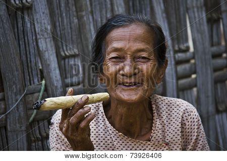 Smiling Asiatic Woman smoking