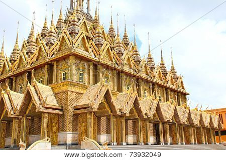 Golden pagoda at Wat Tha Sung Temple in Uthai Thani Thailand. poster