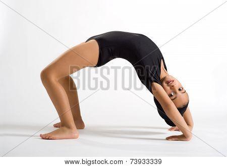 Supple Girl Bending Backwards To Form A Bridge