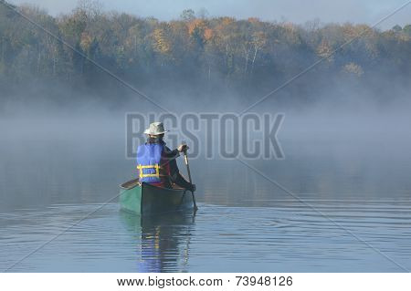 Canoeing On An Autumn Lake