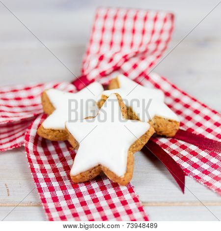 xmas cookies with icing  on wooden table poster