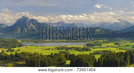 panorama landscape in Bavaria with alps mountains nearby city Fuessen poster