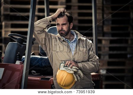 Exhausted warehouse worker having a break