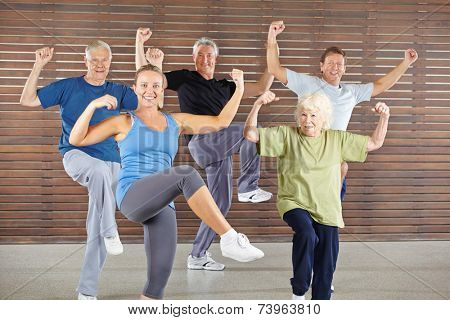 Happy senior group doing a bokwa class in gym