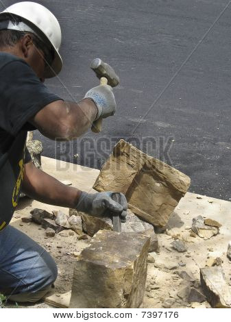 Stone Manson Fits Stone In New Wall