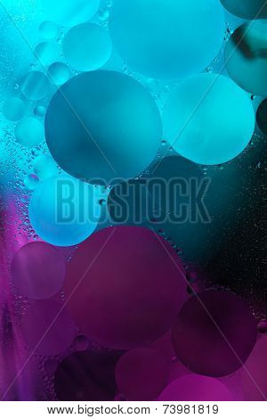 Pruple blue Gradient Oil drops in the water -abstract background
