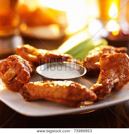 buffalo barbecue hot chicken wings around ranch sauce with celery