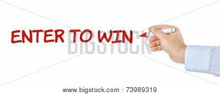 Hand with pen writing the words Enter to win