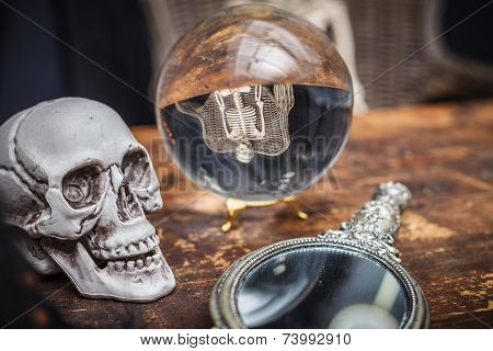 Skull, Old Mirror And Crystal Ball With Reflection Skeleton