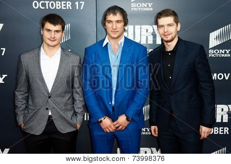 WASHINGTON, DC-OCT 15: NHL players Dmitry Orlov (L), Alex Ovechkin (C) and Evgeny Kuznetsov of the Washington Capitals at