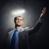 Young handsome businessman and yin yang symbol above head poster
