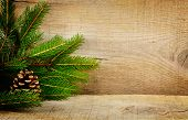 Wooden christmas background with spruce with pine cone poster