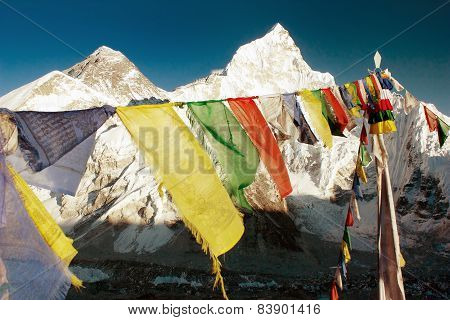 evening view of Mount Everest with buddhist prayer flags from Kala Patthar way to Everest base camp Nepal poster