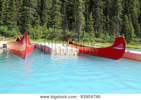 Canoes on beautiful turquoise lake