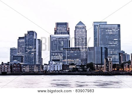 London Canary Wharf financial district at twilight with sky faded to white