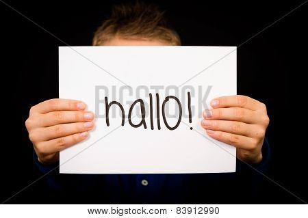 Child Holding Sign With German Word Hallo - Hello In English