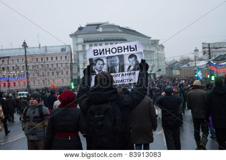 The Oppositionist Bears The Poster In Which Accuses Of Nemtsov's Murder The Top Officials Of The Rus