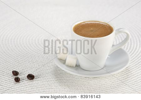 Cup Of Coffee, Sugar Cubes On A White Wicker A Mat