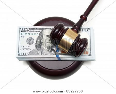 Big Wad Of Money And Gavel Closeup Isolated On A White Background