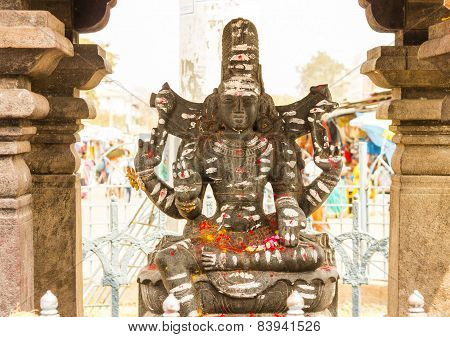 Statue of Lord Shiva in blessing pose at the entrance of Mallikarjuna temple, Srisailam, India poster