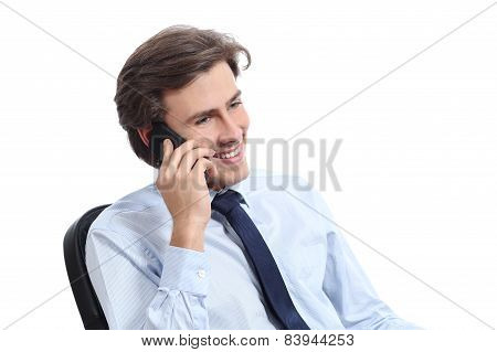 Happy Sitting Businessman Working On The Phone