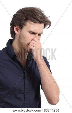 Man Holding His Nose Because Of The Stink