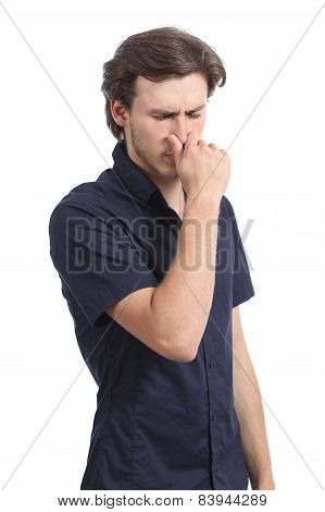 Man Holding His Nose Smelling Stink