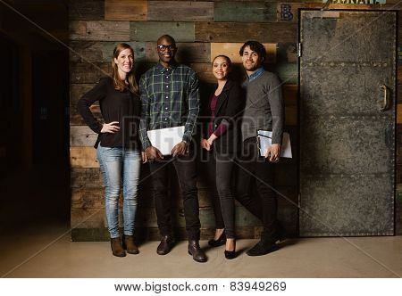 Portrait Of Successful Business Team Standing In An Office