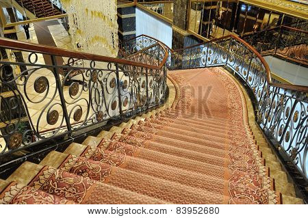 Hall, Stairs And A Large Chandelier In Hotel Lotte