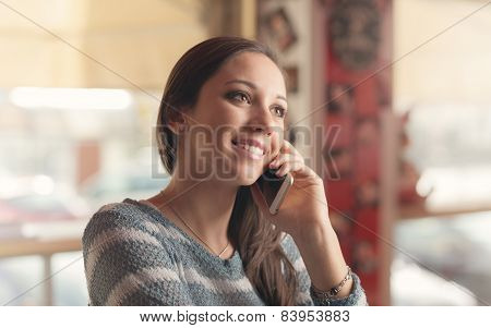 Happy Woman Having A Phone Call