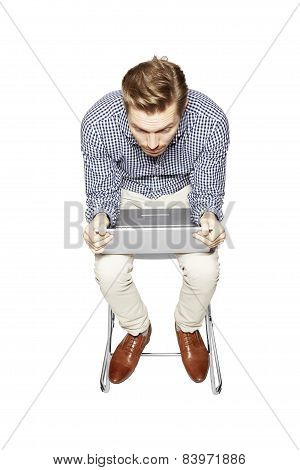 Young Man Leaning Over The Keyboard