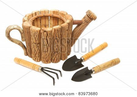 garden tool and wood fiower pot on white background