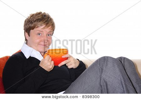 Woman relaxing on a Couch with a Cup of Tea