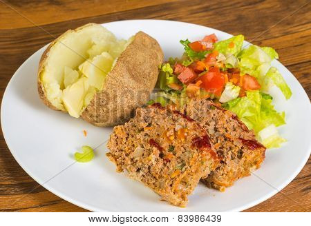 Meatloaf And Baked Potato With Butter