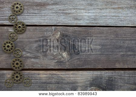 Row Of Gears On A Wooden Background