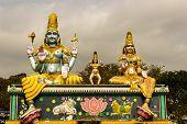 Statue of Lord Mallikaarjuna, Karthikeya and Goddess Bhramarambika at Srisailam, India poster