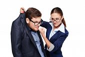 Funny picture of young business man and woman. Strict female boss holding afraid man by collar. Isolated on white background poster