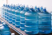 Rows of Big Bottle of Drinking Water Supply poster