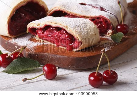 Cherry Strudel On A Wooden Board Close Up. Horizontal
