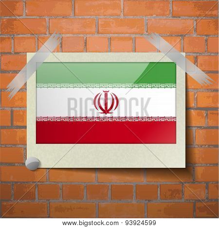 Flags Iran Scotch Taped To A Red Brick Wall