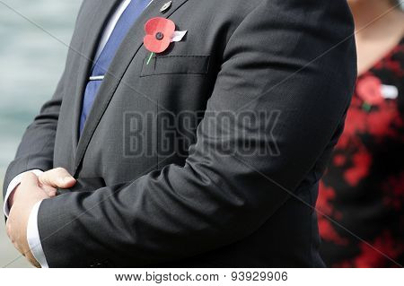 Close up of an ANZAC red poppy on a person during a National War Memorial Anzac Day services in New Zealand.